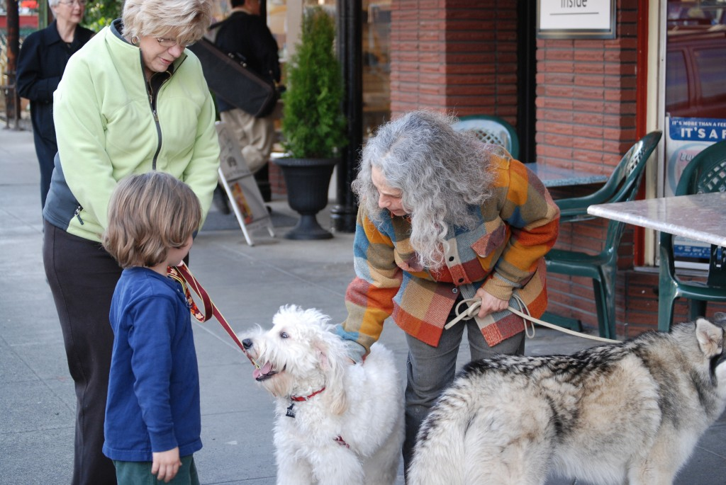 Jeanne helps a dog and child greet one another safely and comfortably.